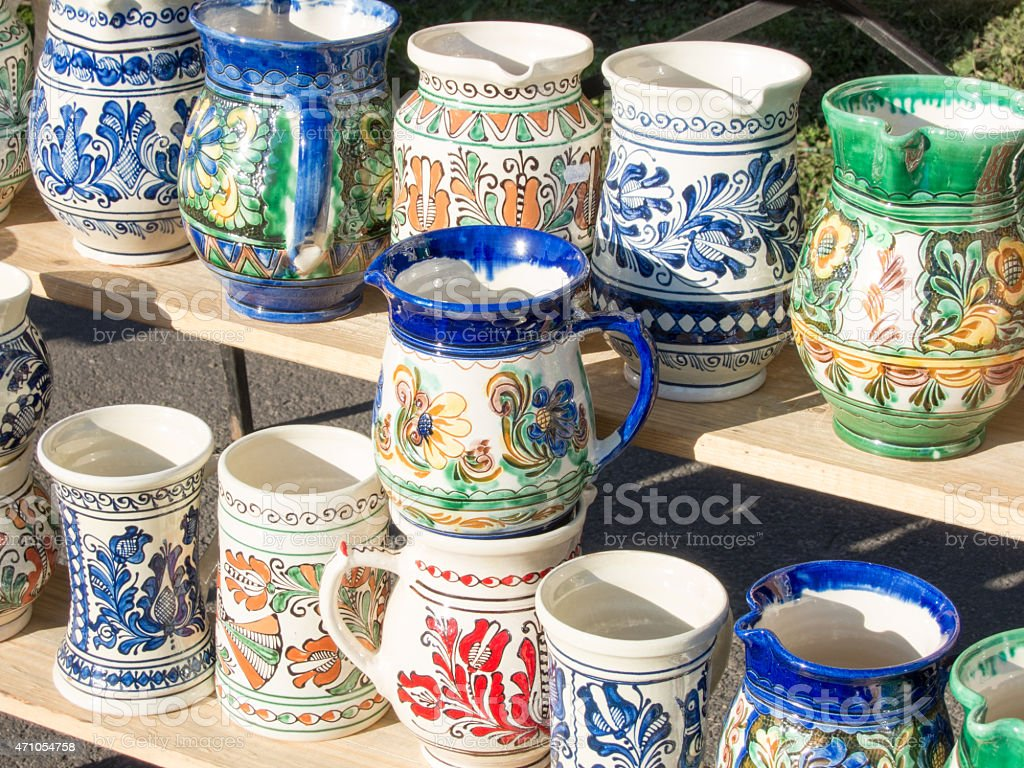 bunch of traditional hadcrafted romanian pottery mugs stock photo