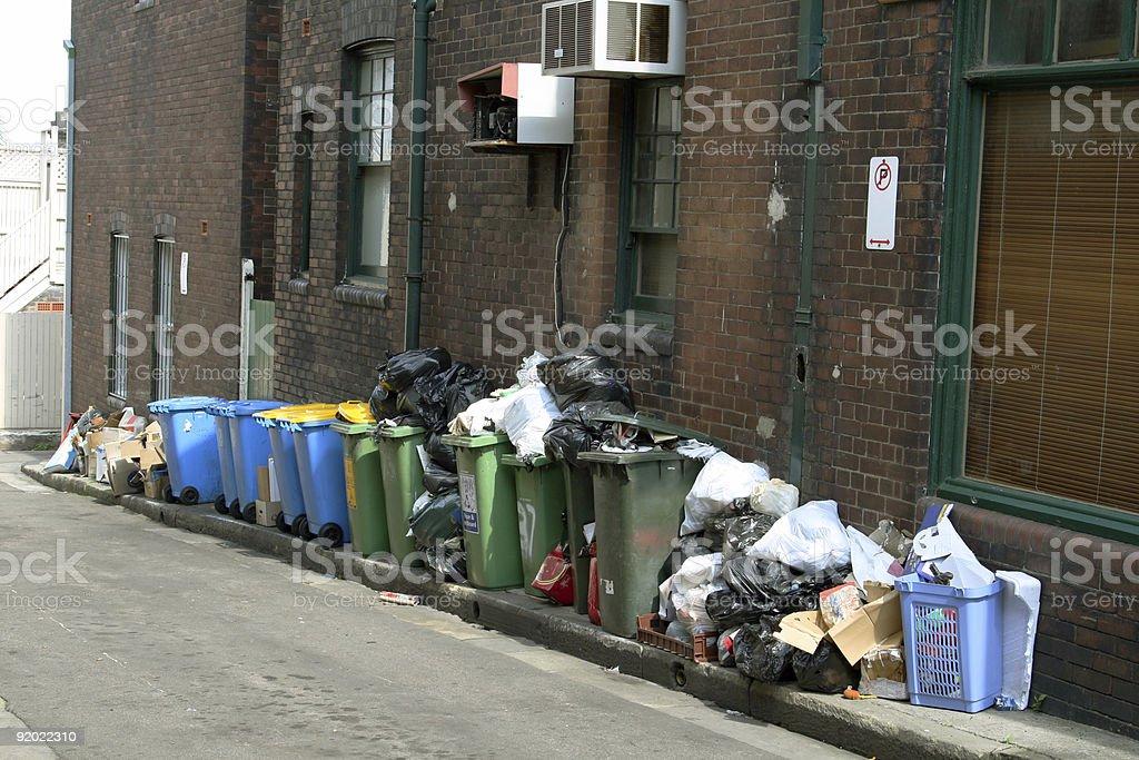 Bunch of trash on street sidewalk royalty-free stock photo