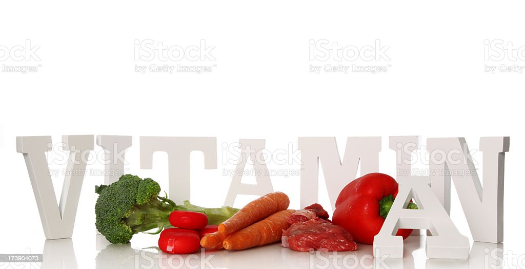 A bunch of vegetables surrounded by vitamin a stock photo