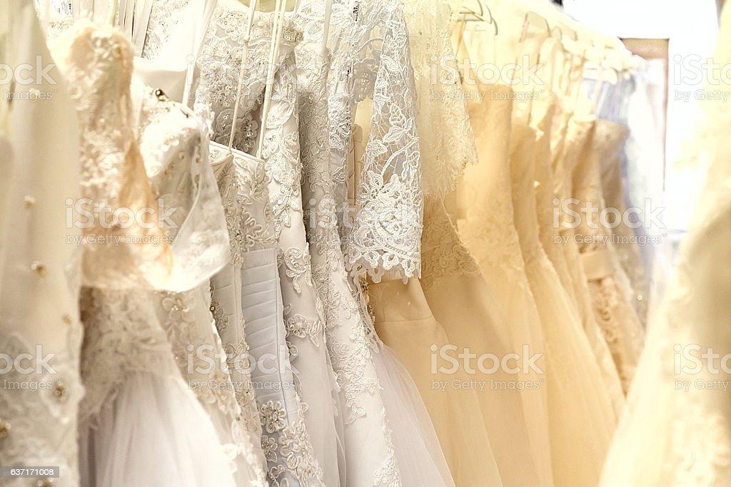 Bunch of wedding dresses horizontal stock photo