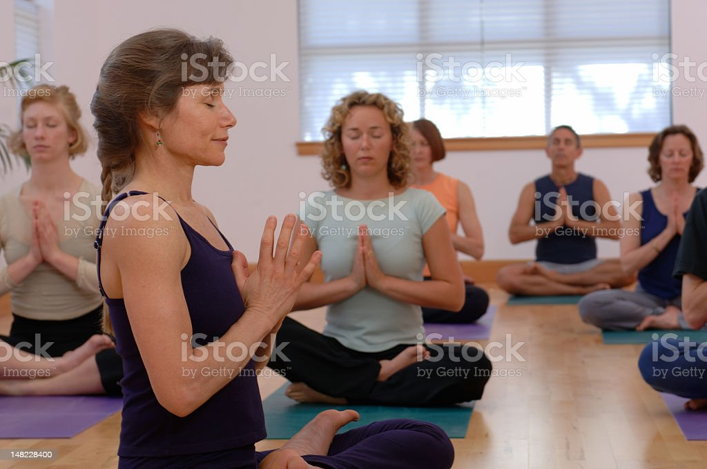 A bunch of women practicing yoga royalty-free stock photo