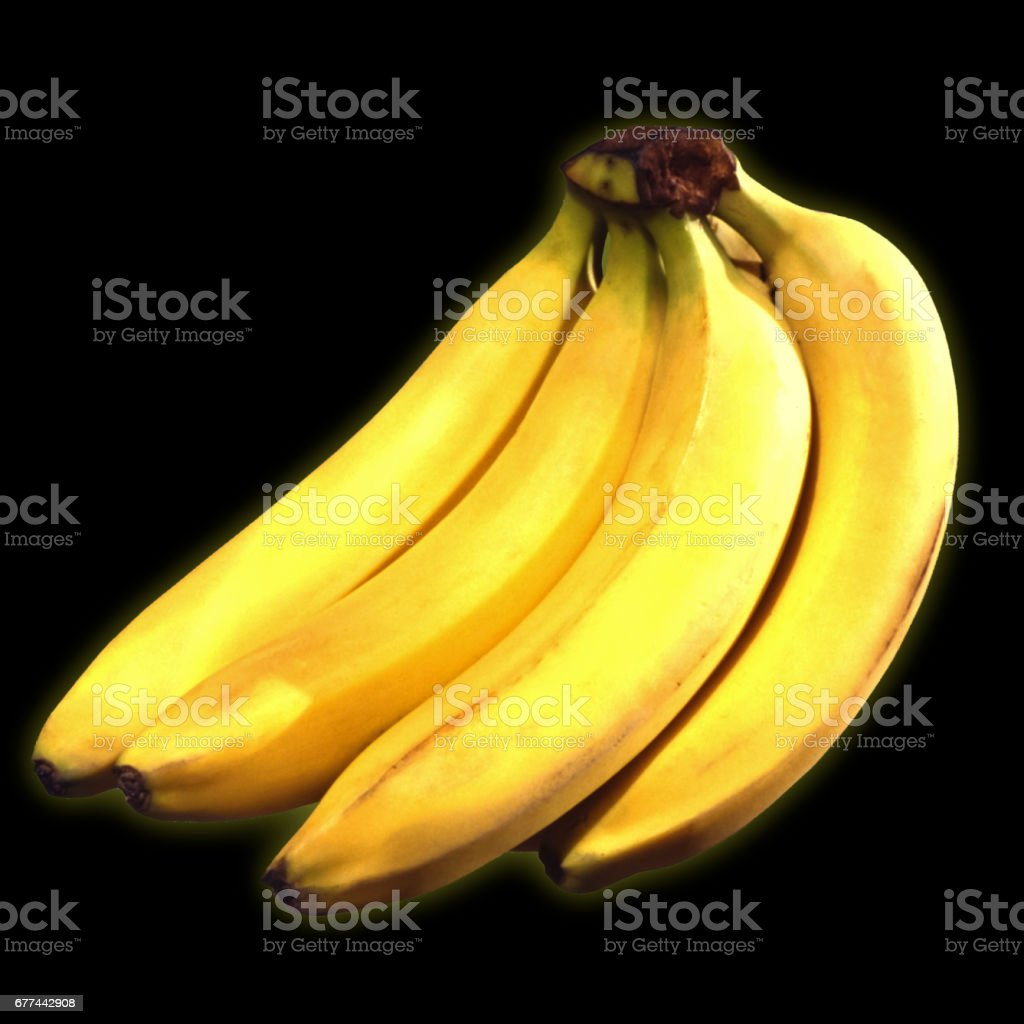Bunch ripe yellow bananas, in front of a black background. stock photo