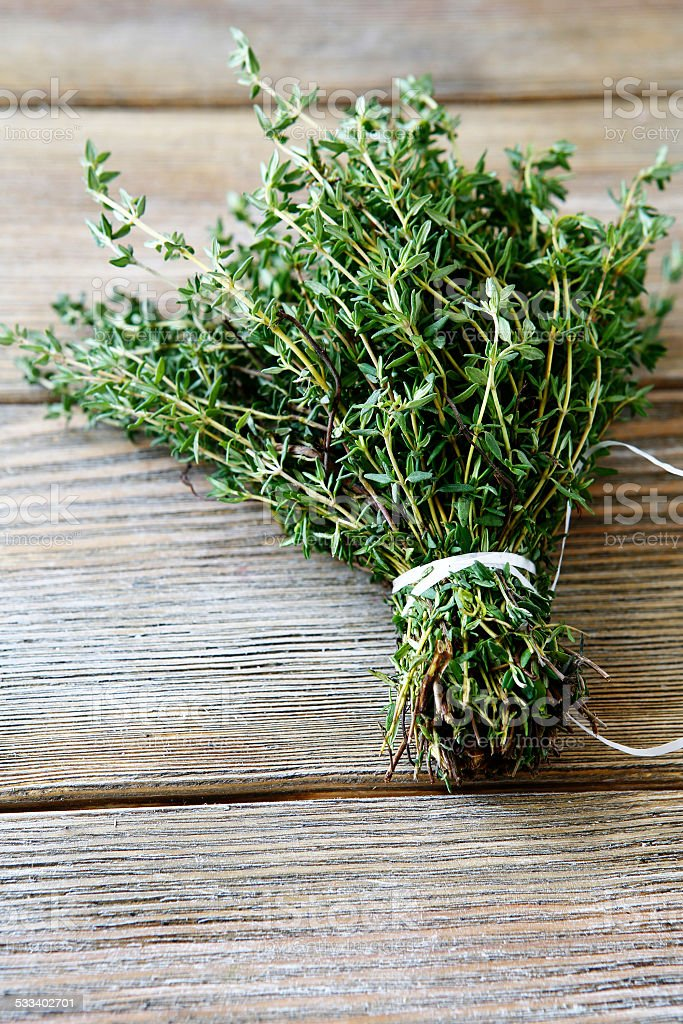 Bunch thyme on wooden boards stock photo