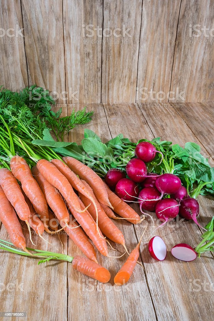 bunches of carrots and radishes stock photo
