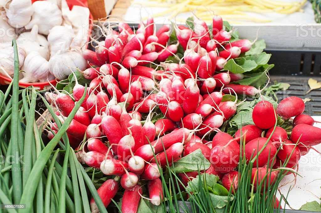 Bunches of Radishes on Sale at Market stock photo