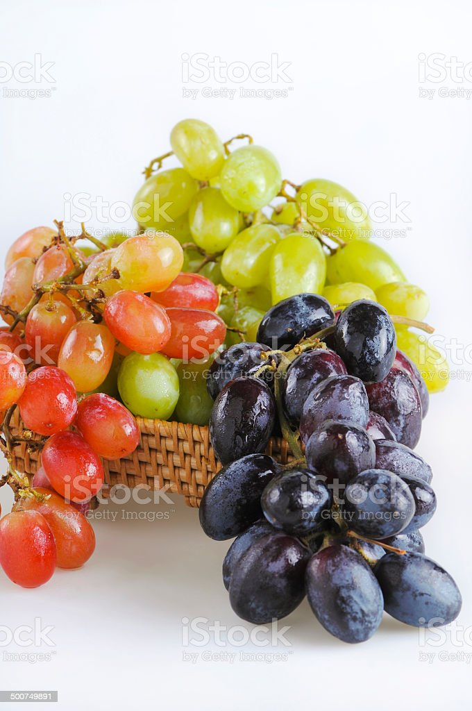 Bunchses of red, blue and green grapes stock photo