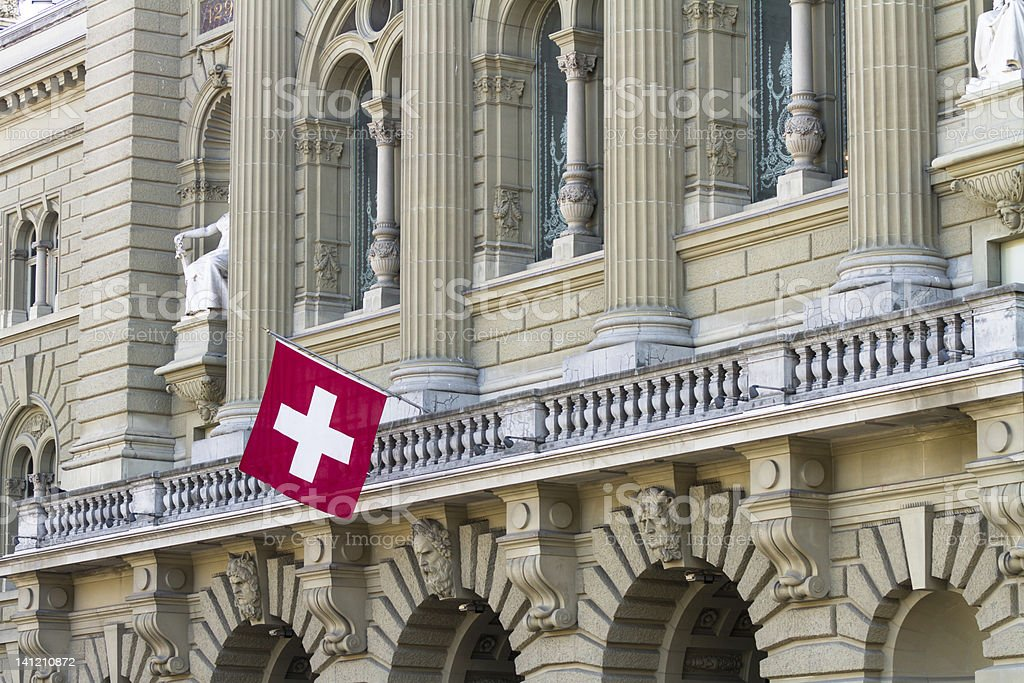 Bundeshaus Facade with Swiss Flag in Bern stock photo