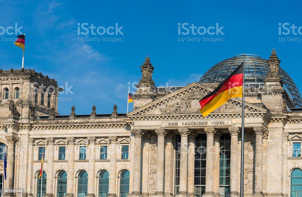 Bundestag - German Parliament and waving German and EU flag stock photo