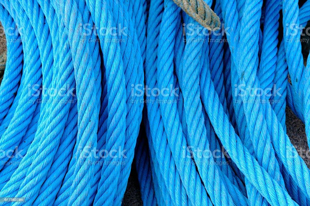 Bundle of blue ropes stock photo