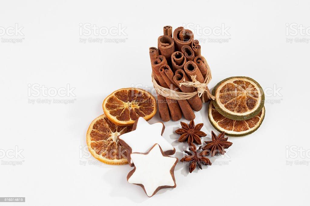 Bundle of cinnamon sticks staranises dried orange slices stock photo