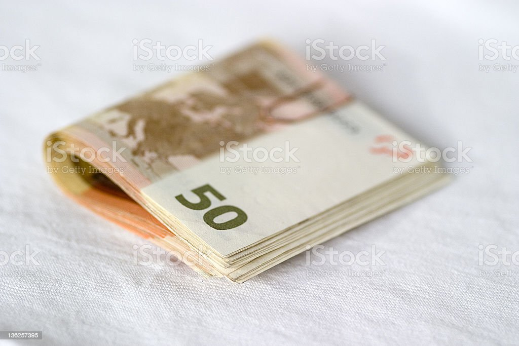 bundle of euros stock photo