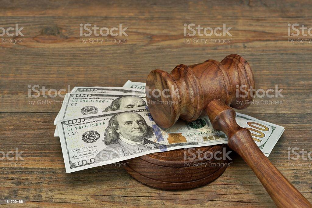 Bundle Of Money, Judges Gavel And Soundboard On Wooden Table stock photo