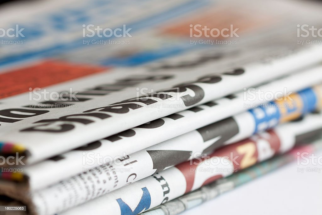 Bundle of newspapers. stock photo