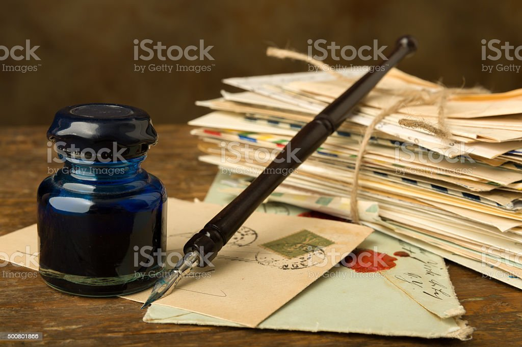 Bundle of old letters and ink well stock photo