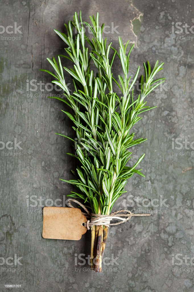 A bundle of rosemary tied together with string and labelled stock photo