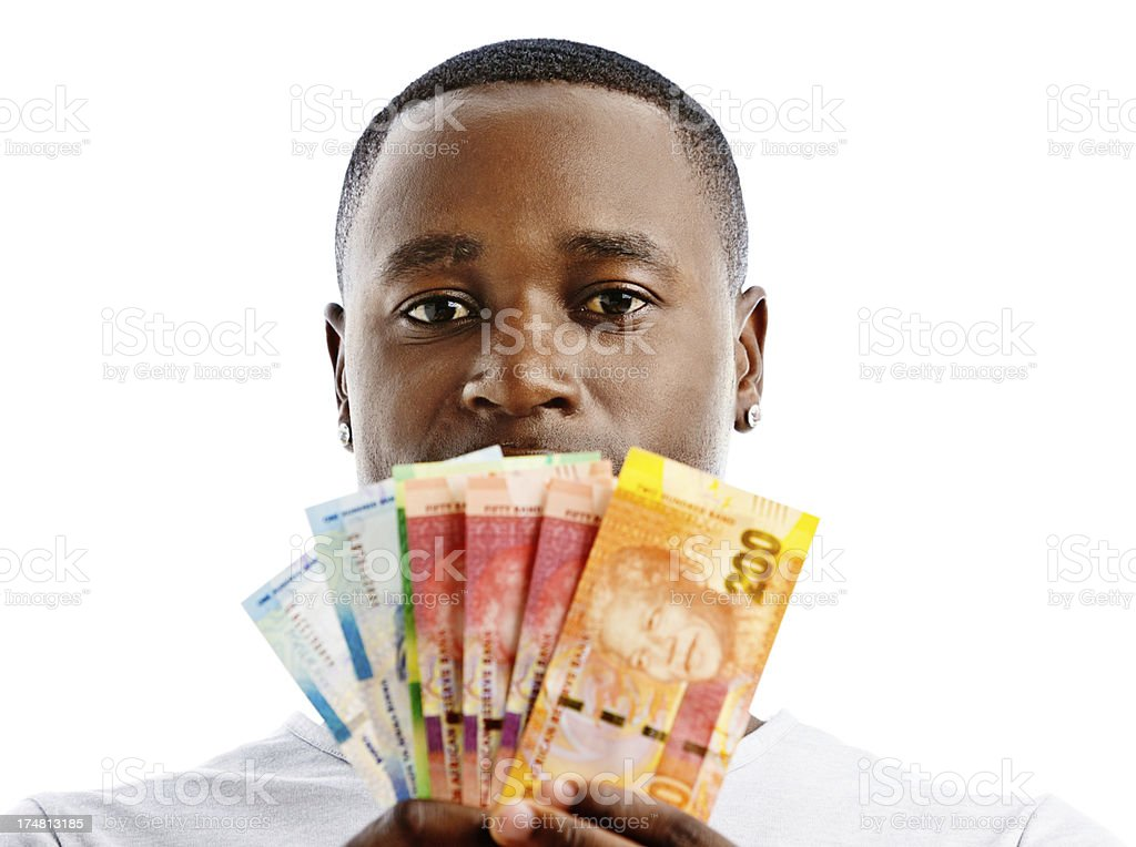 Bundle of South African banknotes obscures serious man's face stock photo