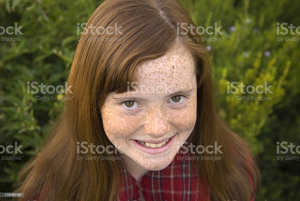 Bundled Up Redhead Girl with Freckles royalty-free stock photo