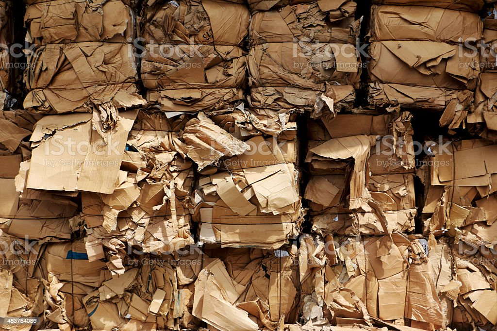 Bundles of cardboard ready for transport stock photo