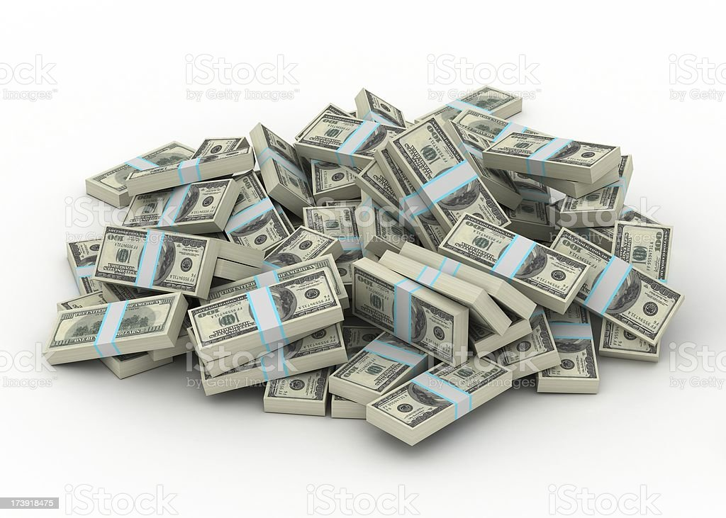 Bundles of United States dollars piled over a white surface stock photo