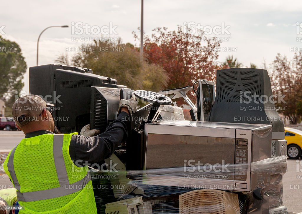 Bundling Up Discarded Electronics for Recycling stock photo