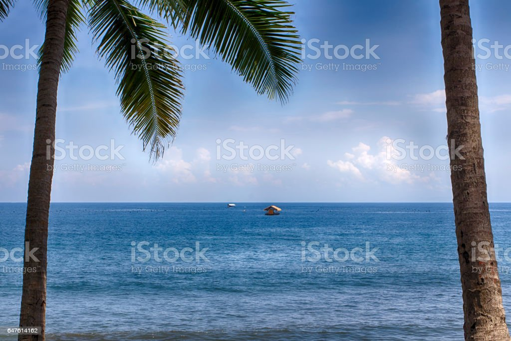 Bungalow in the ocean, hut far from the island of Bali. stock photo