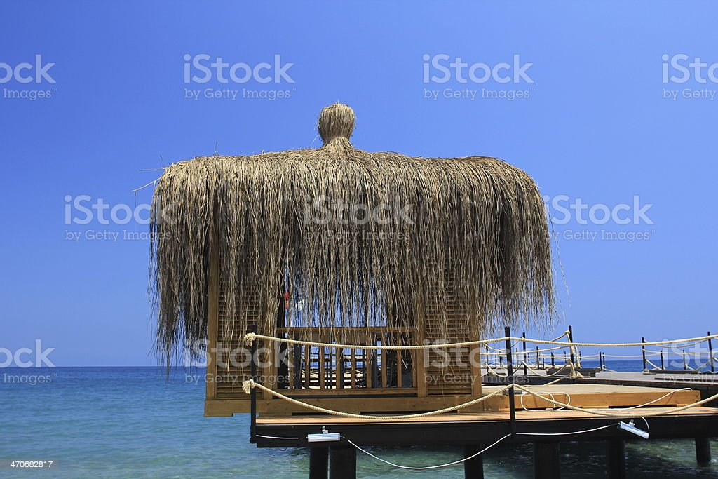 Bungalow on the sea shore royalty-free stock photo