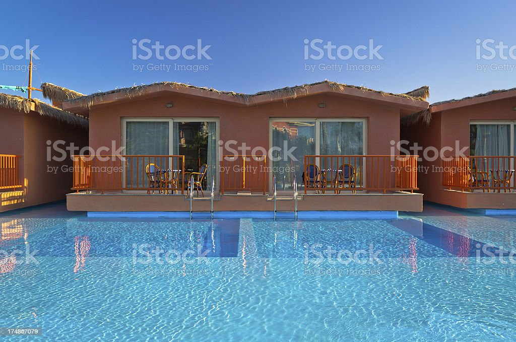Bungalows by the pool royalty-free stock photo