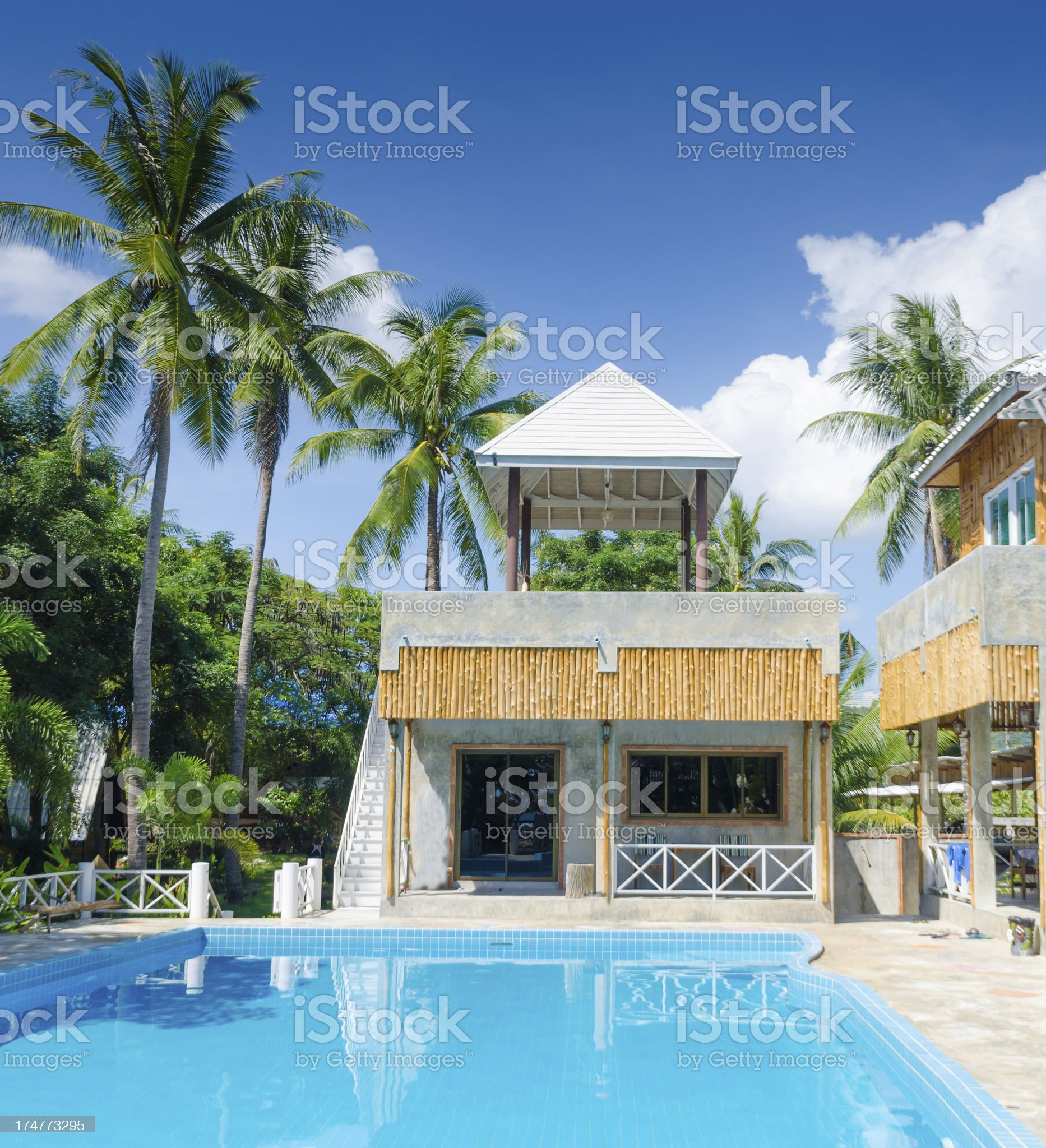 Bungalows of tropical beach resort at sunny day royalty-free stock photo