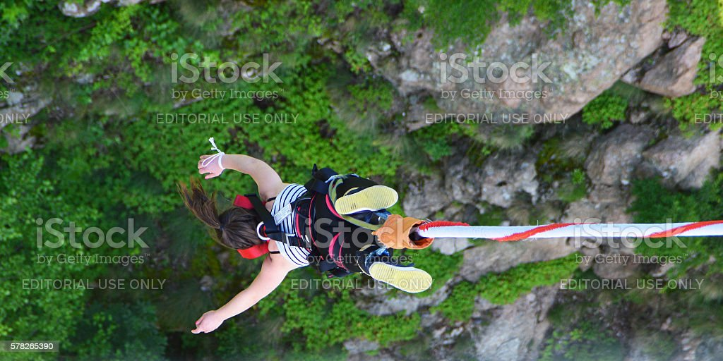 Bungee jumper girl falling down stock photo