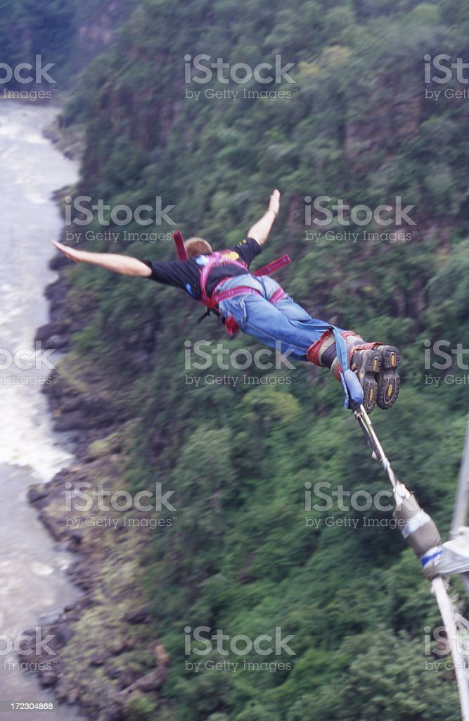 Bungee jumper in mid air with arms outstretched stock photo