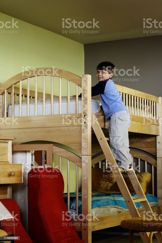 Bunk Beds with Playful Child stock photo