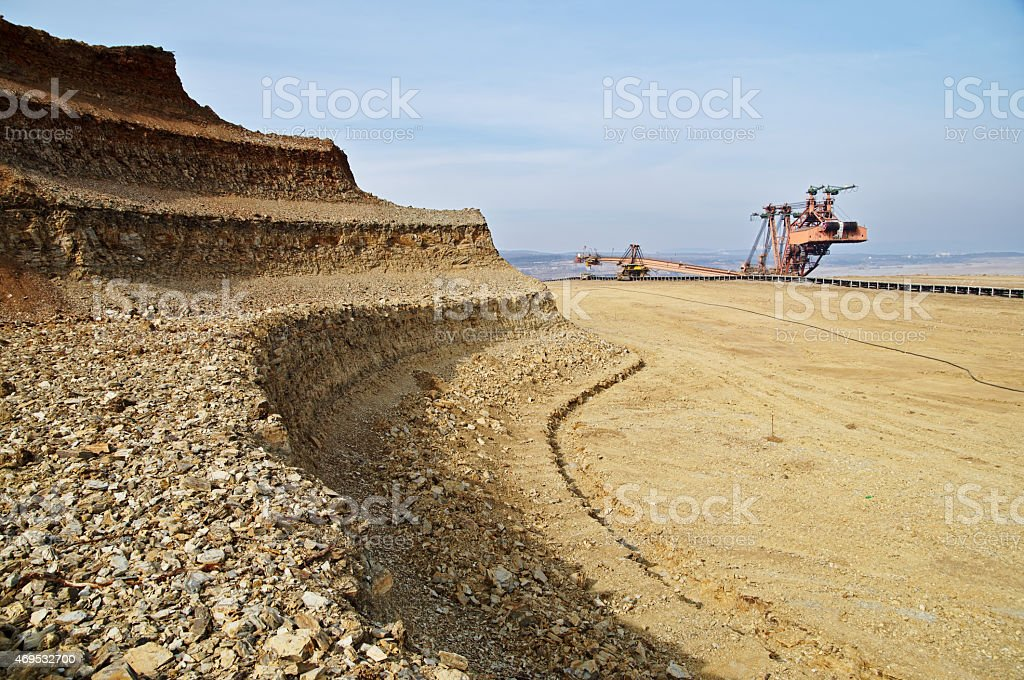 Bunk wall excavated pit mine. Mining giant excavator. stock photo