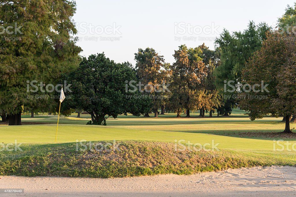 Bunker and Green at Sunset Golf Course. stock photo