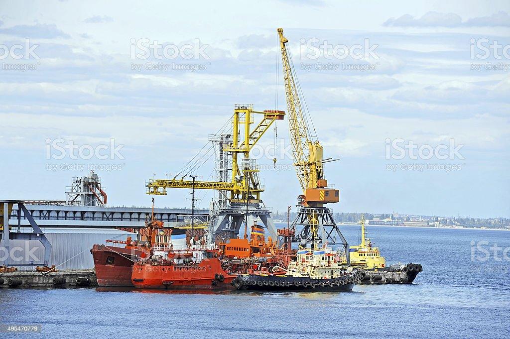 Bunker ship and tugboat under port crane stock photo