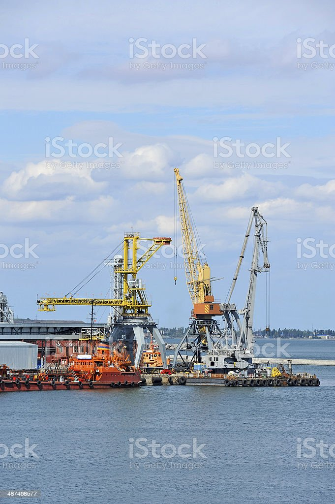 Bunker ship (fuel replenishment tanker) under port crane stock photo