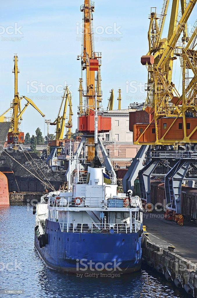 Bunkering ship under port crane stock photo