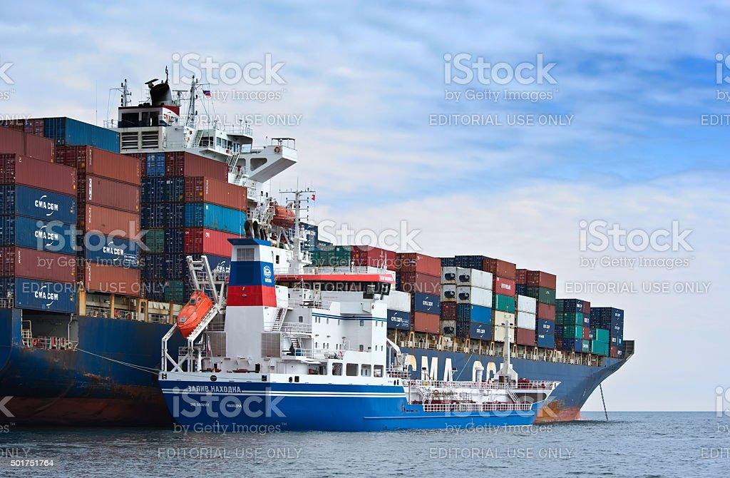 Bunkering tanker Zaliv Nakhodka a container ship CMA CGM Marlin. stock photo