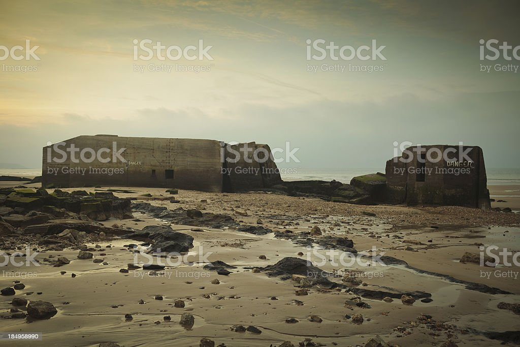 WOII bunkers on the beaches of Normandy France at Dusk stock photo
