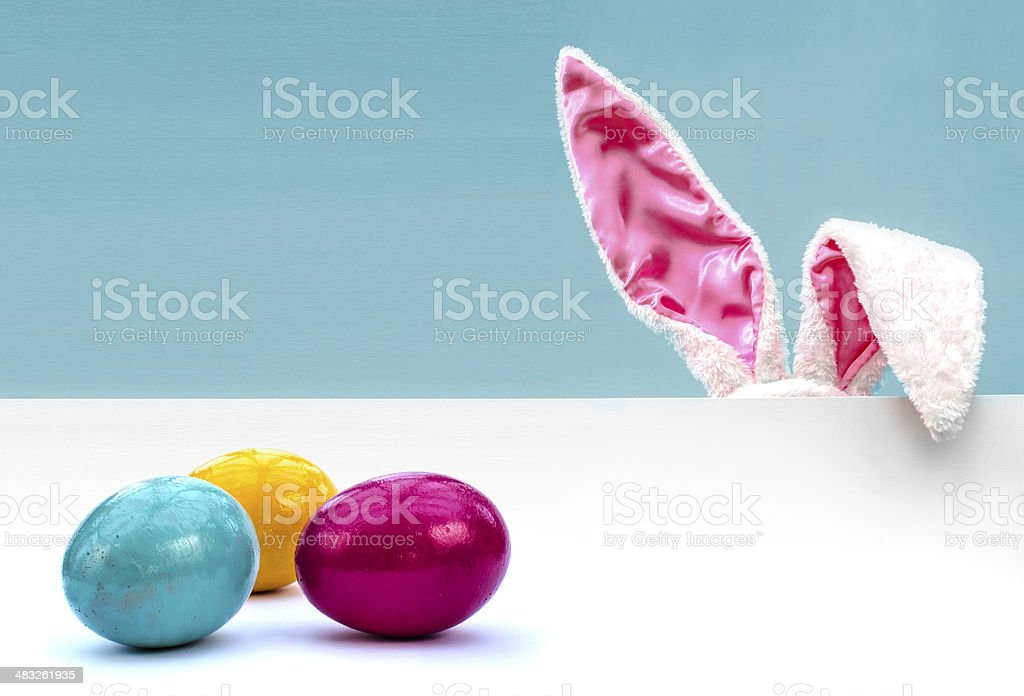 Bunny ears and Easter eggs stock photo