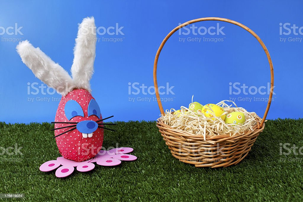 Bunny egg on garden with basket stock photo
