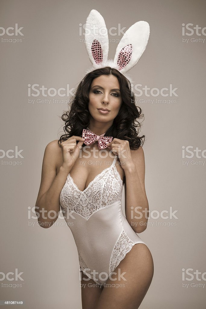 Bunny Girl adjusting her bow tie stock photo