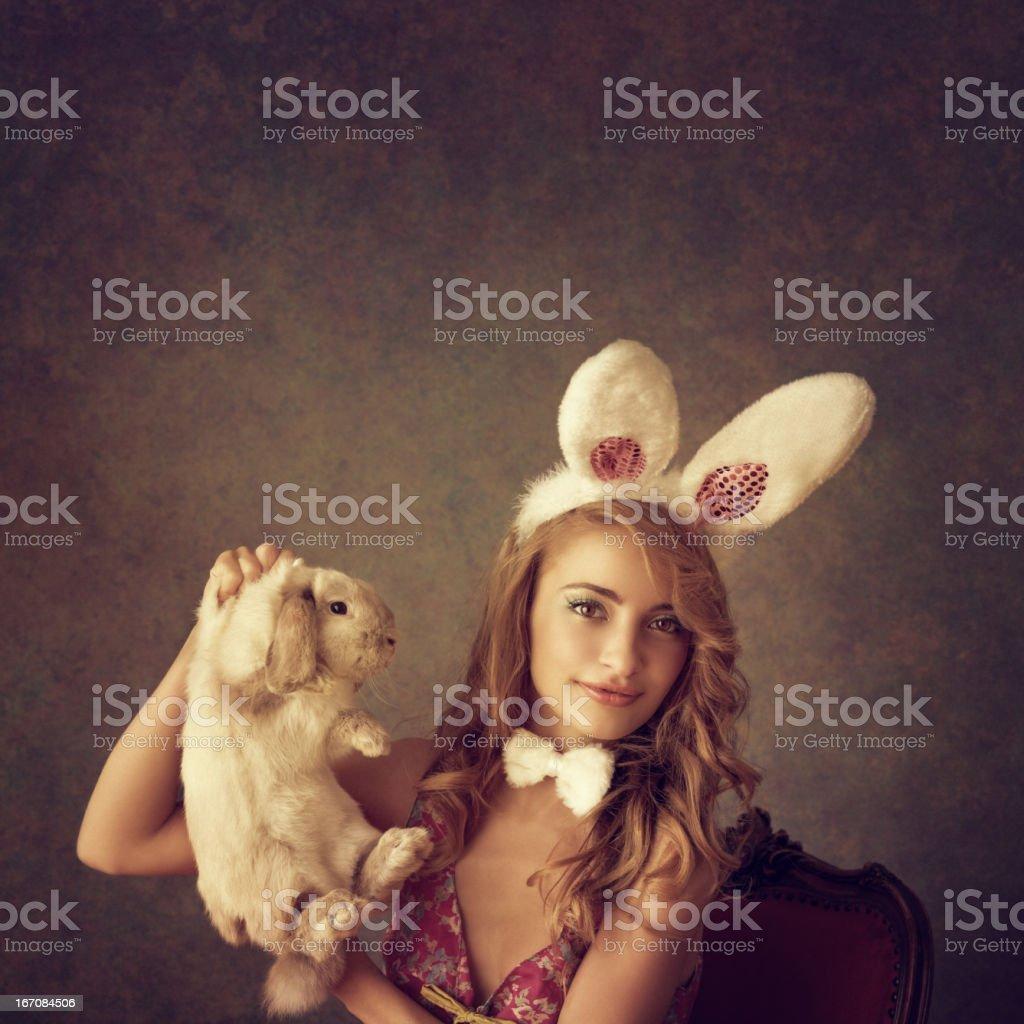 bunny girl holding a rabbit royalty-free stock photo