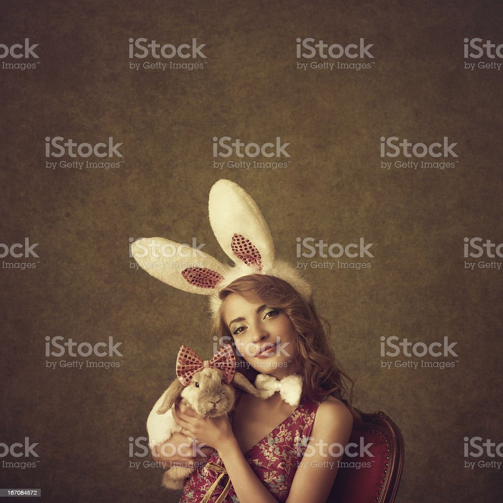 bunny girl holding a rabbit royalty-free stock photo
