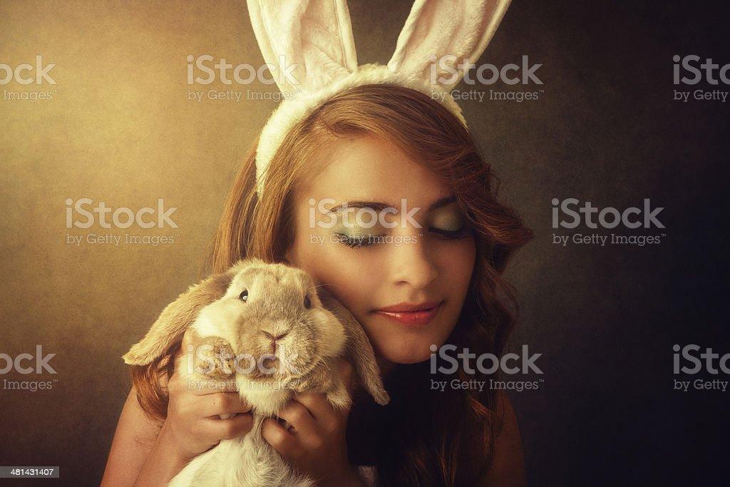 bunny girl holding a rabbit stock photo
