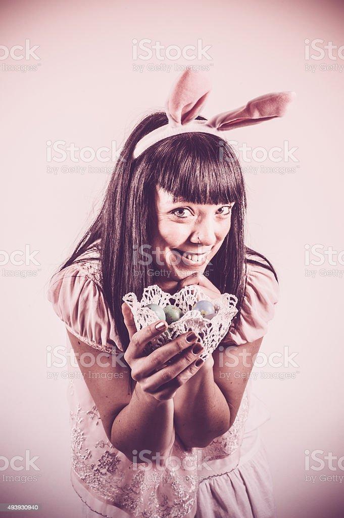 Bunny Girl Holding Easter Eggs stock photo
