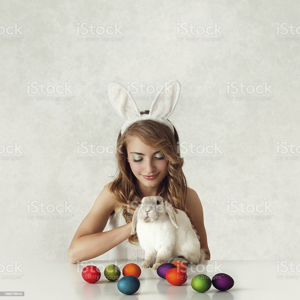 bunny girl with baby rabbit and easter eggs stock photo