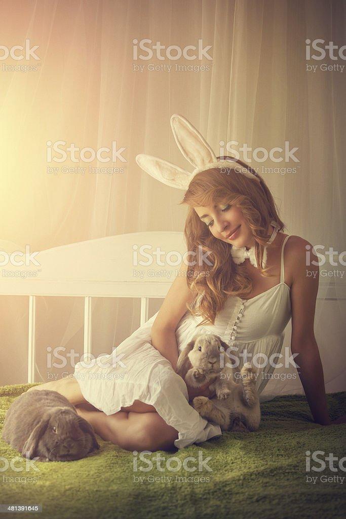 bunny girl with baby rabbits stock photo