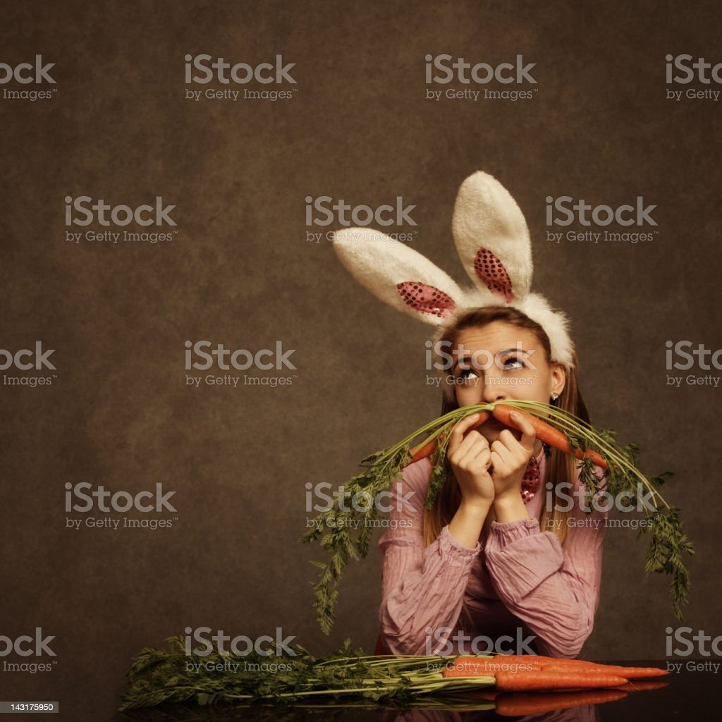 bunny girl with carrot mustache stock photo