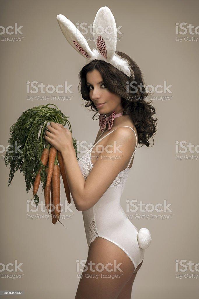 Bunny Girl with carrots stock photo