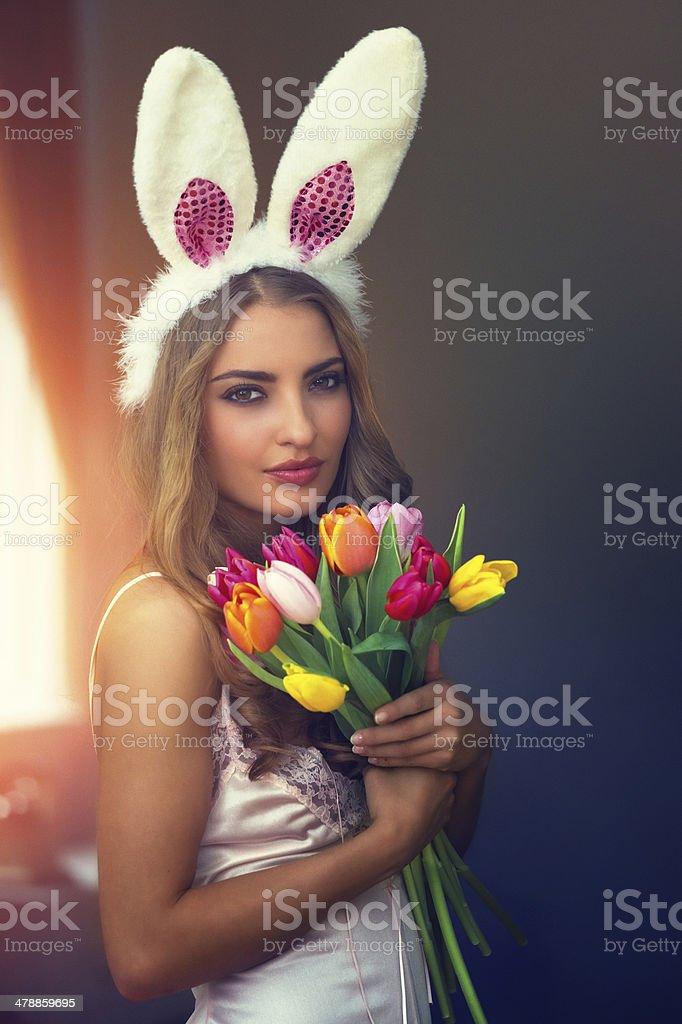 Bunny Girl with tulips stock photo